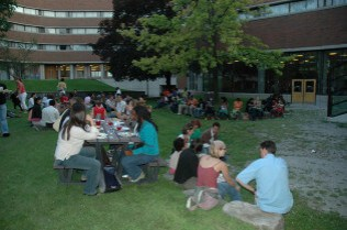 Youth delegates from around the world network in the New College Quad.